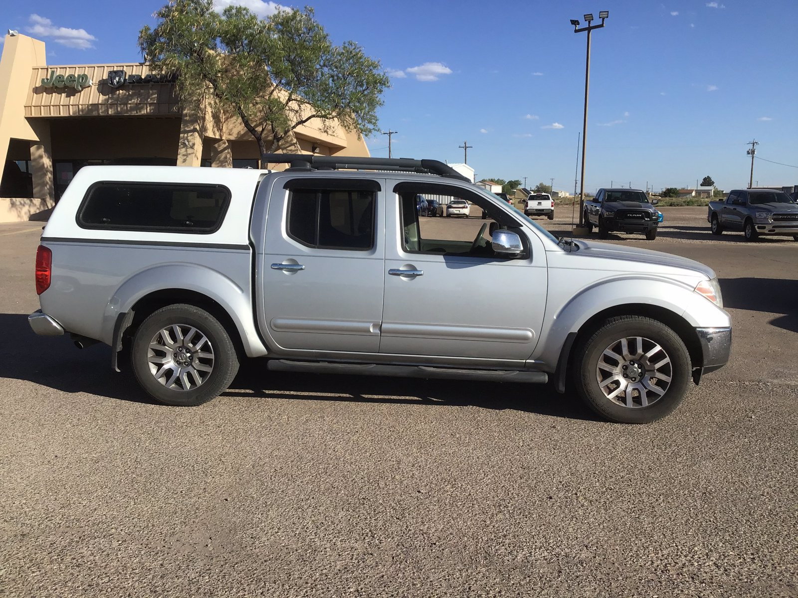 Pre-Owned 2012 Nissan Frontier SL